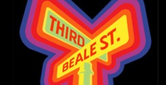 The top of a pair of perpendicular road signs with neon Blue, Purple, Red, and Orange pipping surrounding a neon yellow sign with the red word THIRD above the words Beale St